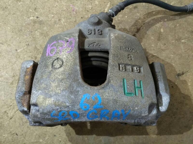 Суппорт тормозной Mazda Axela BK 2003 передний левый