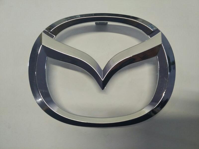 Эмблема решетки радиатора Mazda Axela BK3P