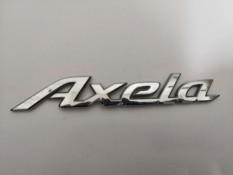 Эмблема багажника Mazda Axela BK3P