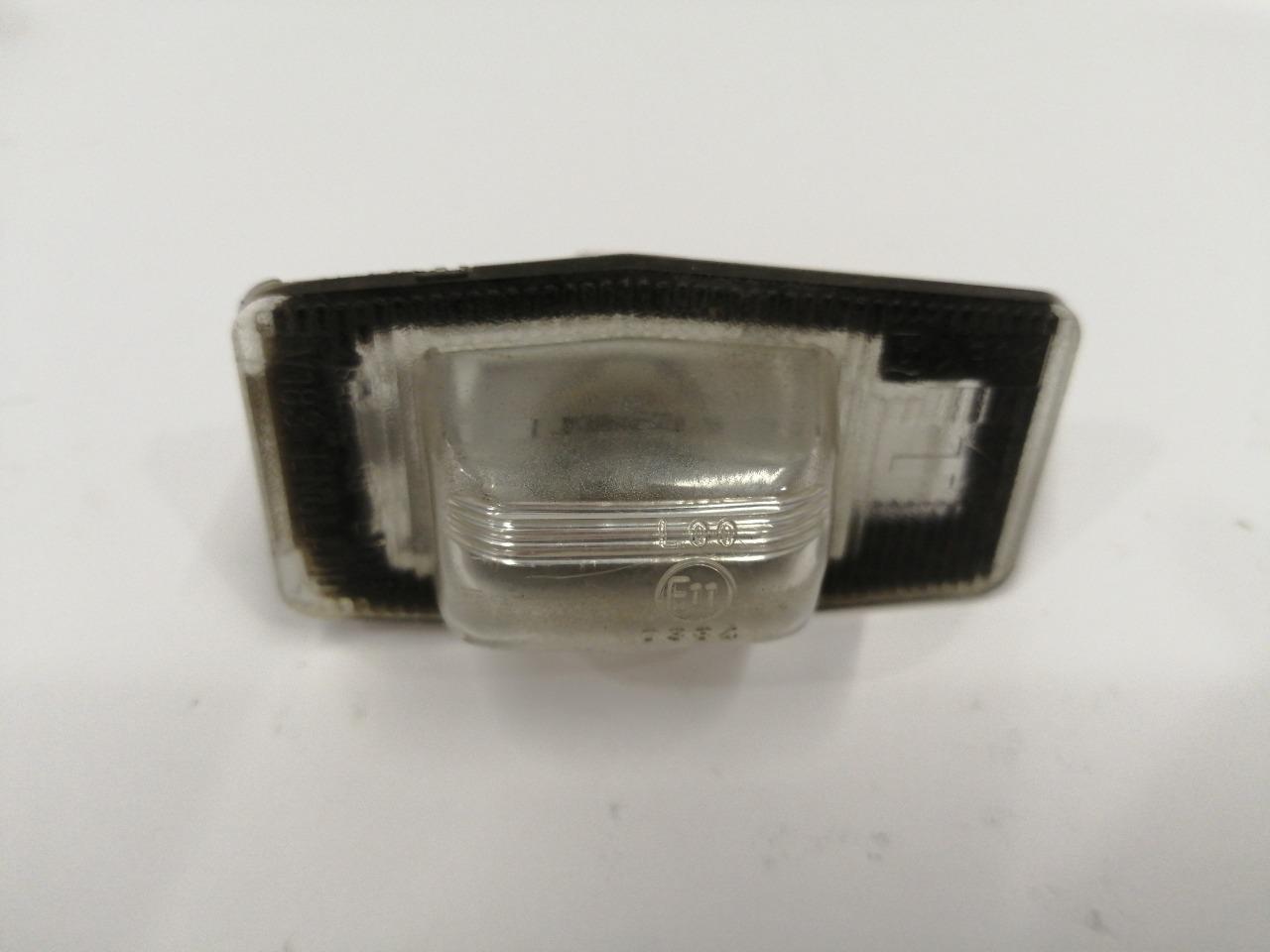Фонарь освещения номера Mazda Familia BJ
