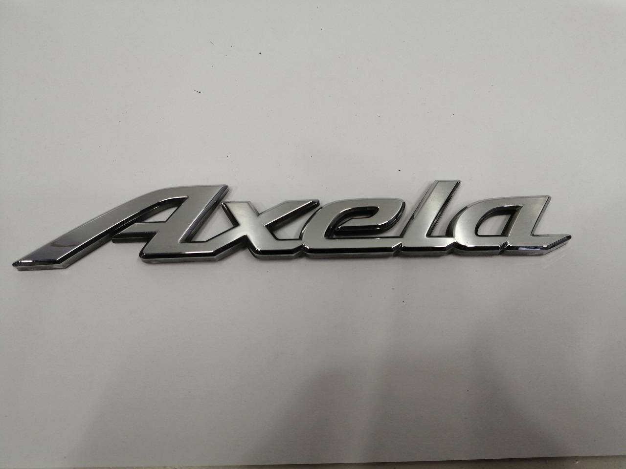 Эмблема багажника Mazda Axela BK3P 2003