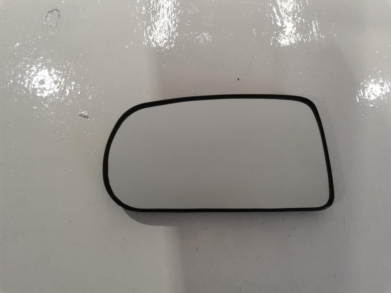 Зеркальный элемент Mazda Familia BHALS левый