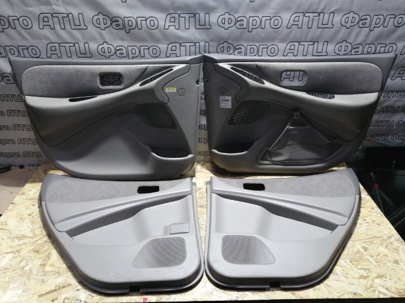 Обшивка двери Nissan Tino V10 QG18DE