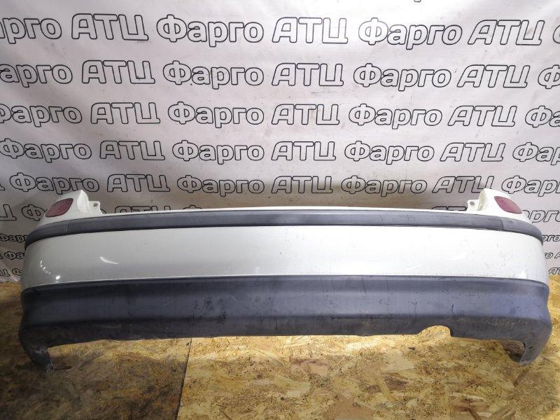 Бампер Nissan Tino V10 QG18DE задний