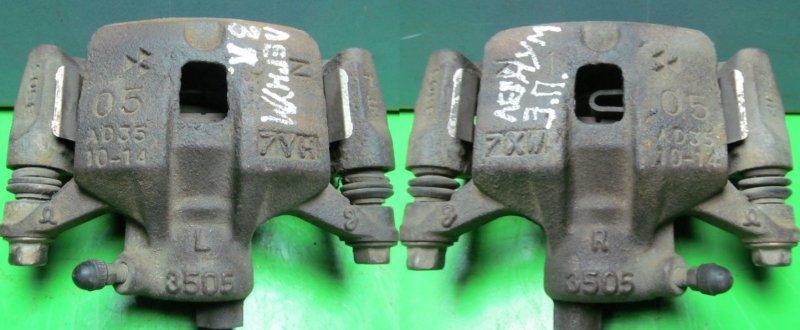 Суппорт тормозной Mitsubishi Legnum задний