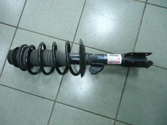 Стойка подвески Toyota Ractis SCP100 2SZ-FE передняя левая