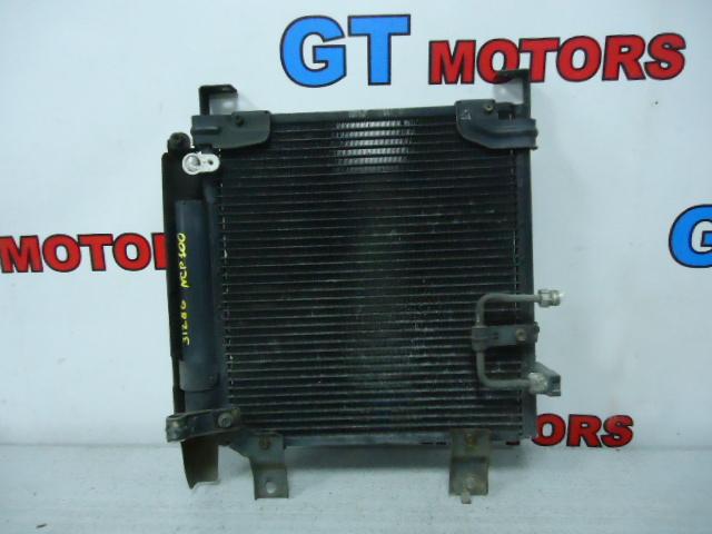 Радиатор кондиционера Toyota Duet M`100A EJ-DE
