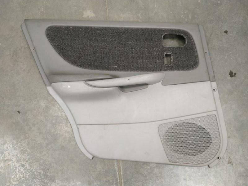 Обшивка двери Mazda Capella GWER FS-DE задняя левая GG2N68550-04