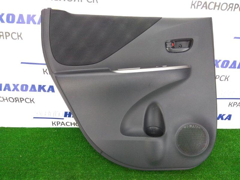 Обшивка двери Toyota Ractis NCP100 1NZ-FE 2005 задняя левая 67614-X1V00 задняя левая, черная ( салон FA10)