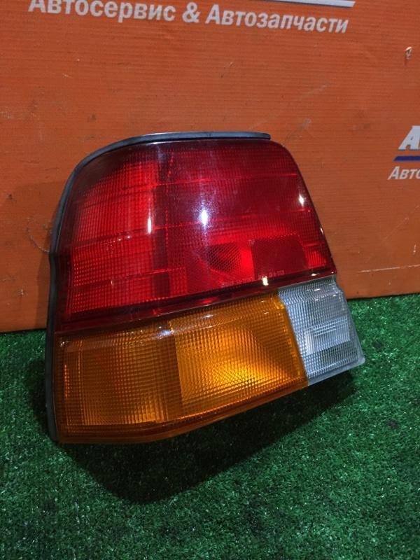 Фонарь задний Toyota Tercel EL51 4E-FE 1994 задний левый 16-117 1мод седан 3-х цветный