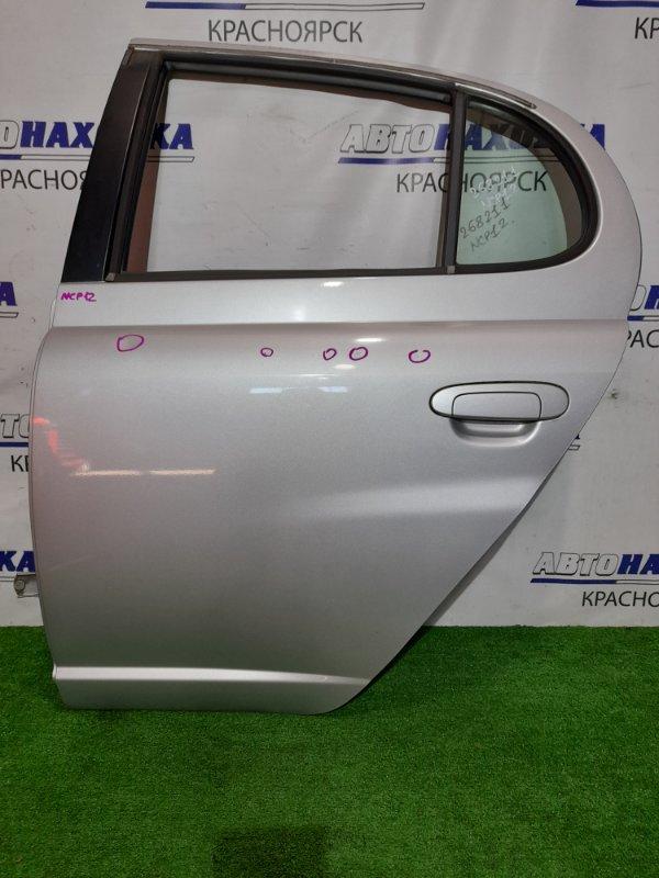 Дверь Toyota Platz NCP12 1NZ-FE 1999 задняя левая RL в сборе. Цвет 1C0. Есть мелкие коцки и одна тычка