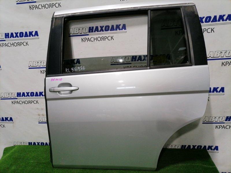 Дверь Toyota Isis ANM10G 1AZ-FSE 2004 задняя левая Задняя левая, цвет 1F7. Есть пара малозаметных
