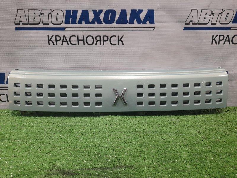Решетка радиатора Mazda Carol HB24S K6A 2004 71741-72J есть потертости до пластика (см. фото)