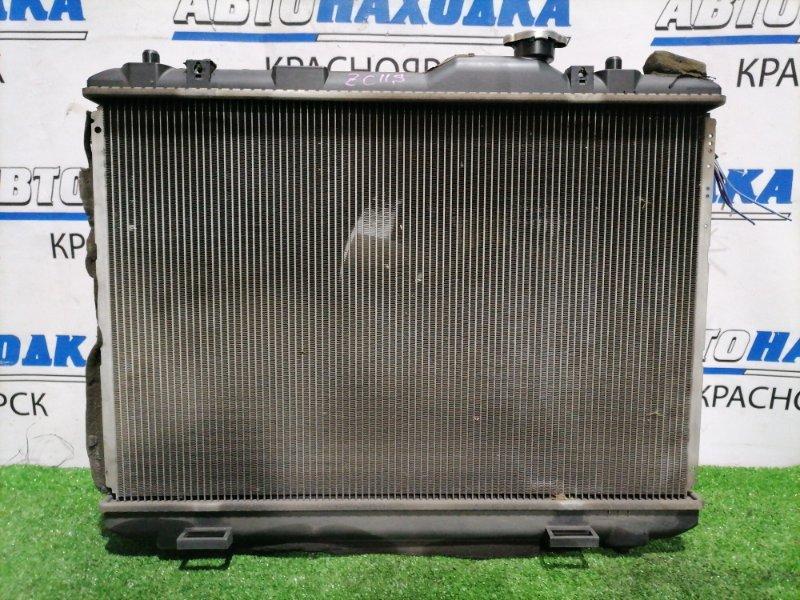 Радиатор двигателя Suzuki Swift ZC11S M13A 2004 222000-2110 с диффузором и вентилятором.