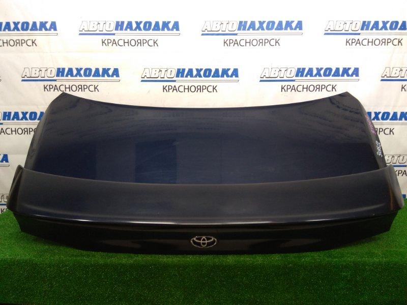 Крышка багажника Toyota Curren ST206 3S-FE 1995 задняя темно-синяя (8L2), со спойлером, скол на