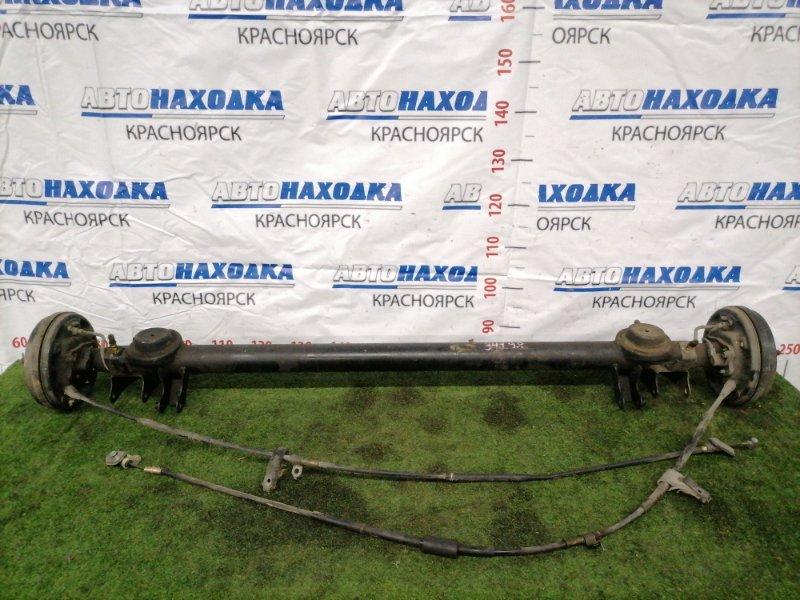 Балка поперечная Suzuki Chevrolet Cruze HR52S M13A 2001 задняя Задняя в сборе. Тросики ручника целые.
