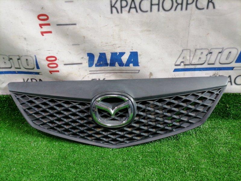 Решетка радиатора Mazda Demio DY3W ZJ-VE 2002 Дорестайлинг (1 мод.), дефект одной защелки.