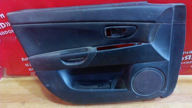 Обшивка двери Mazda 3 передняя левая