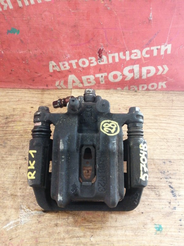 Суппорт тормозной Honda Stepwgn RK1 R20A 2009 задний левый