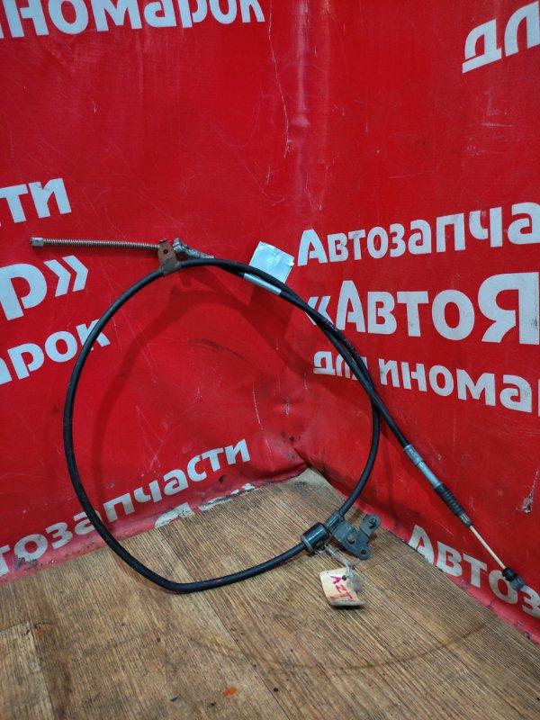 Тросик ручника Toyota Opa ACT10 1AZ-FSE задний левый