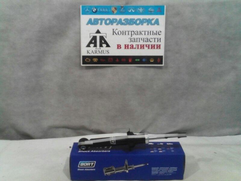 Амортизатор Nissan Almera N16E YD22DD задний