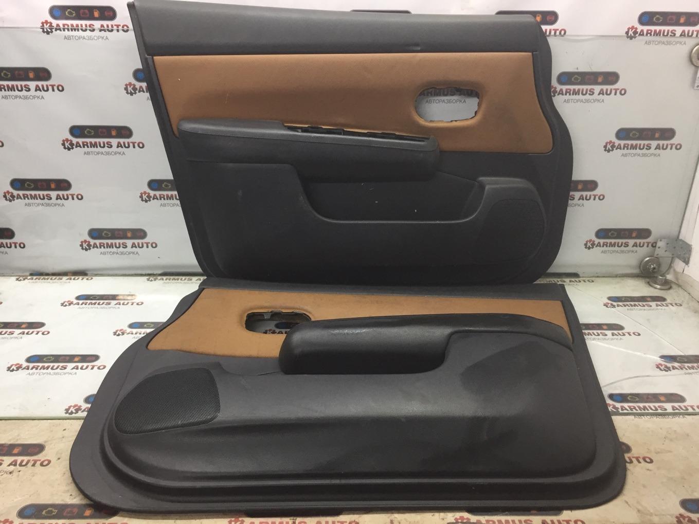 Обшивка двери Nissan Tiida C11 HR15DE