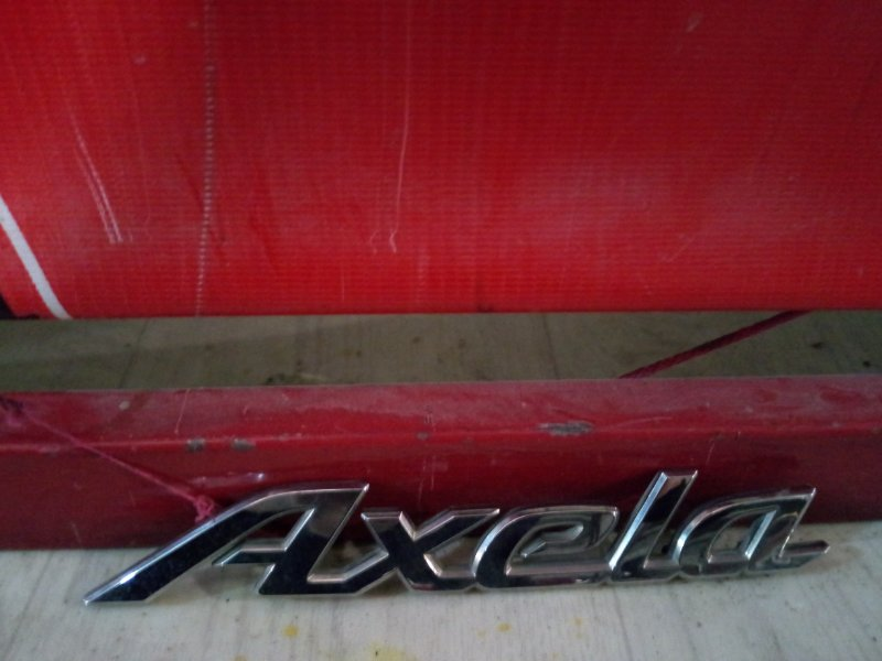 Эмблема Mazda Axela BK5P ZY-VE 2003 задняя