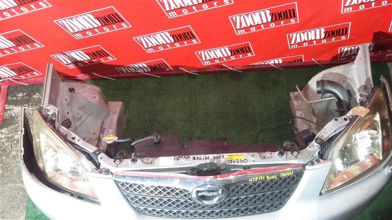 Рамка радиатора Toyota Corolla Runx NZE121 1NZ-FE 2003 передняя серебро