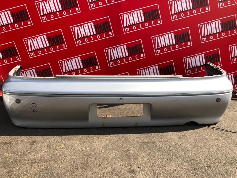 Бампер Mitsubishi Lancer Cedia CS5W 4G93 2000 задний серебро