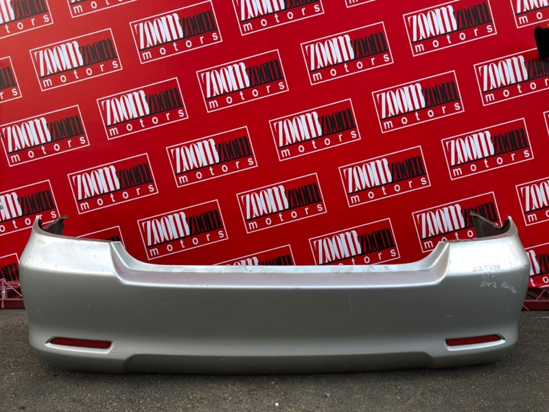 Бампер Toyota Allion ZZT240 1ZZ-FE `2001 задний серебро