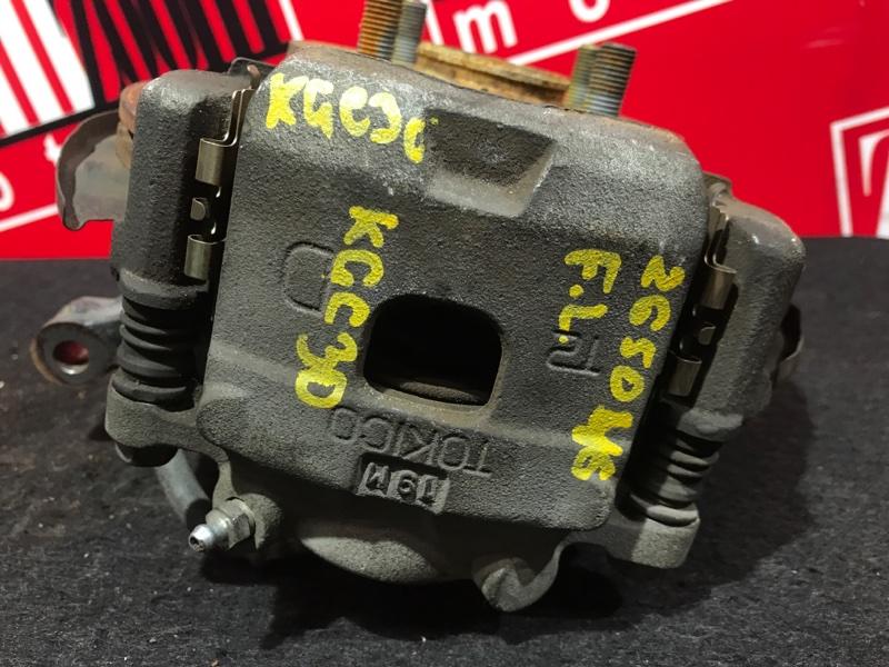 Суппорт Toyota Passo KGC30 1KR-FE 2010 передний левый