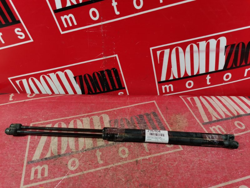 Амортизатор багажника Mazda Demio DY3W ZY-VE 2002 задний