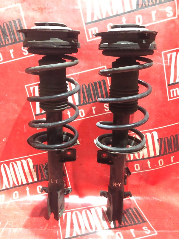 Стойка подвески Nissan Note E11 HR15DE 2008 передняя