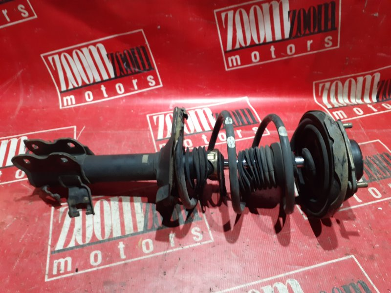 Стойка подвески Nissan Tino V10 QG18DE 1998 передняя правая
