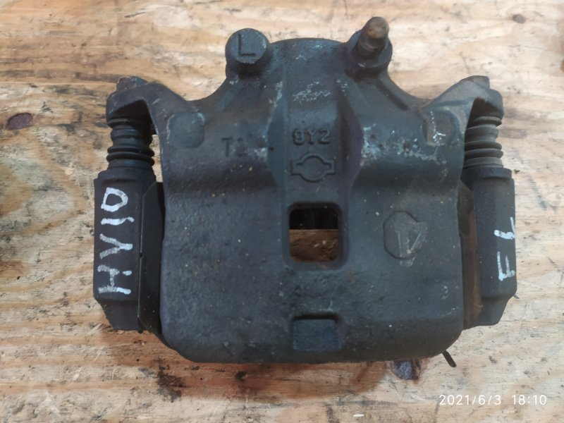 Суппорт Nissan Tino HV10 SR20DE 1999 передний правый