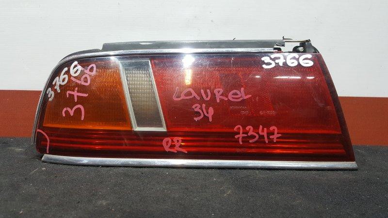 Задний фонарь Nissan Laurel GC34 задний левый 7347 Сломана оправа (см. фото). (б/у)