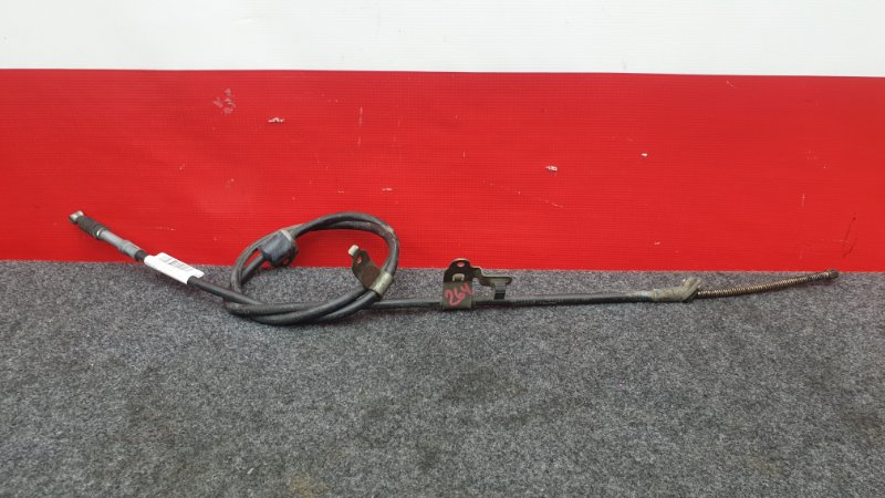 Тросик ручного тормоза Toyota Corolla Fielder NZE121 1NZ 2003 задний левый (б/у)
