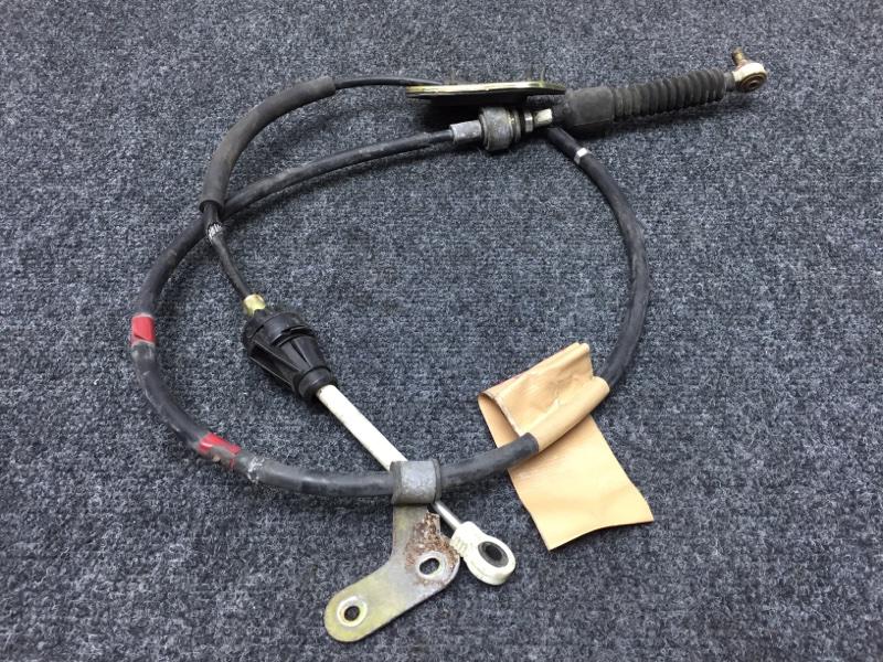 Тросик переключения кпп Toyota Corolla Fielder NZE121 1NZ 2003 Поврежден кожух тросса (см. (б/у)