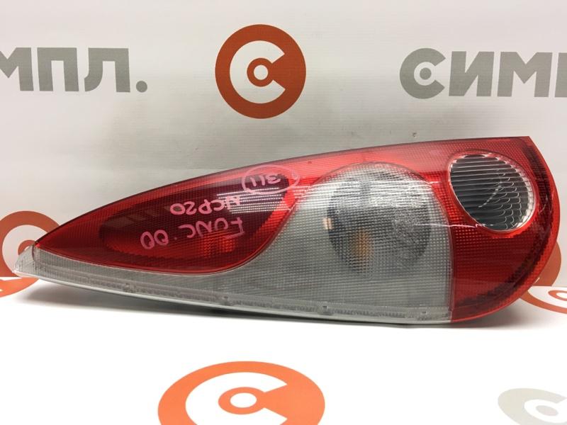 Задний фонарь Toyota Funcargo NCP20 2NZ 2000 задний левый 52-027 Дефект: трещины на пластике (см. (б/у)