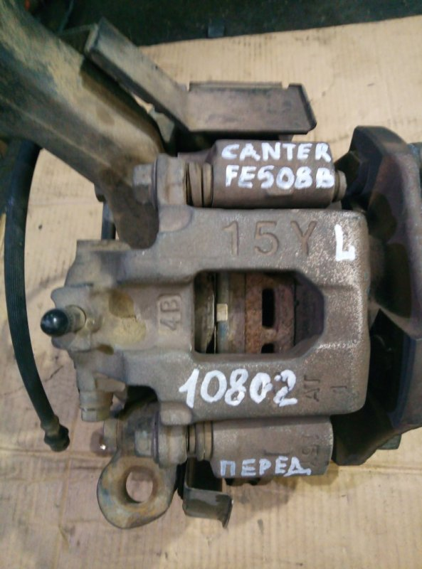 Тормозной суппорт Mitsubishi Canter FE508B 4D35 1995 передний левый