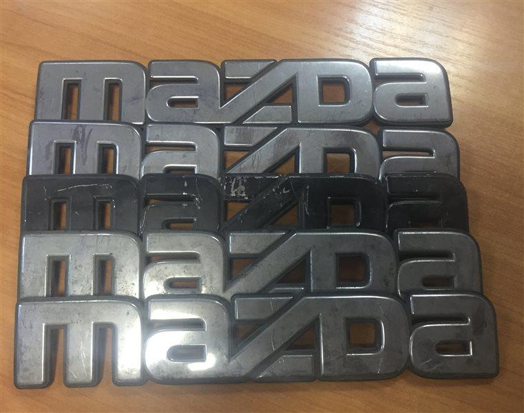 Надпись Mazda Titan