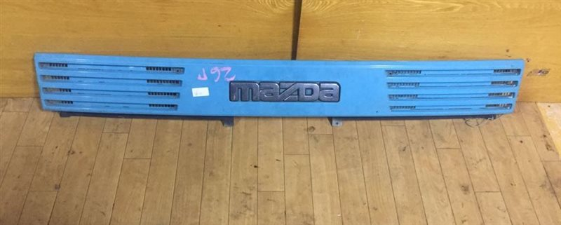 Планка над фарами Mazda Titan WGLAT SL/HA/TF/TM 89