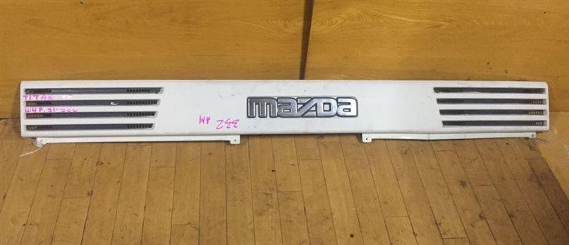 Планка над фарами Mazda Titan WGE4T SL/HA/TF/TM 91