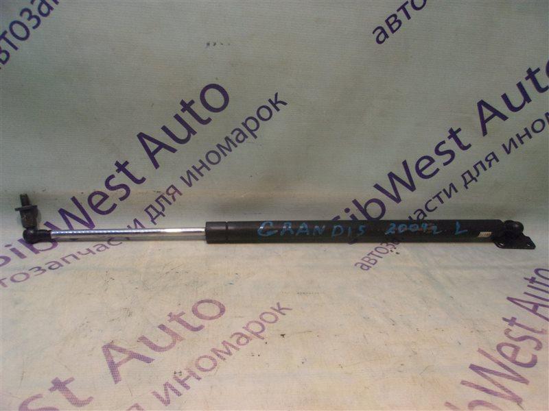 Амортизатор задней двери Mitsubishi Grandis NA4W левый