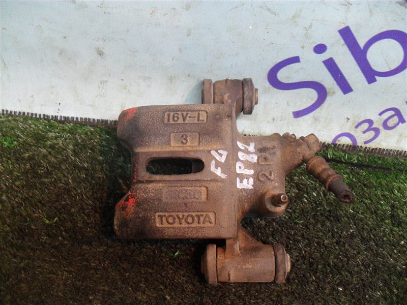 Суппорт Toyota Starlet EP82 4E-F 1991 передний левый