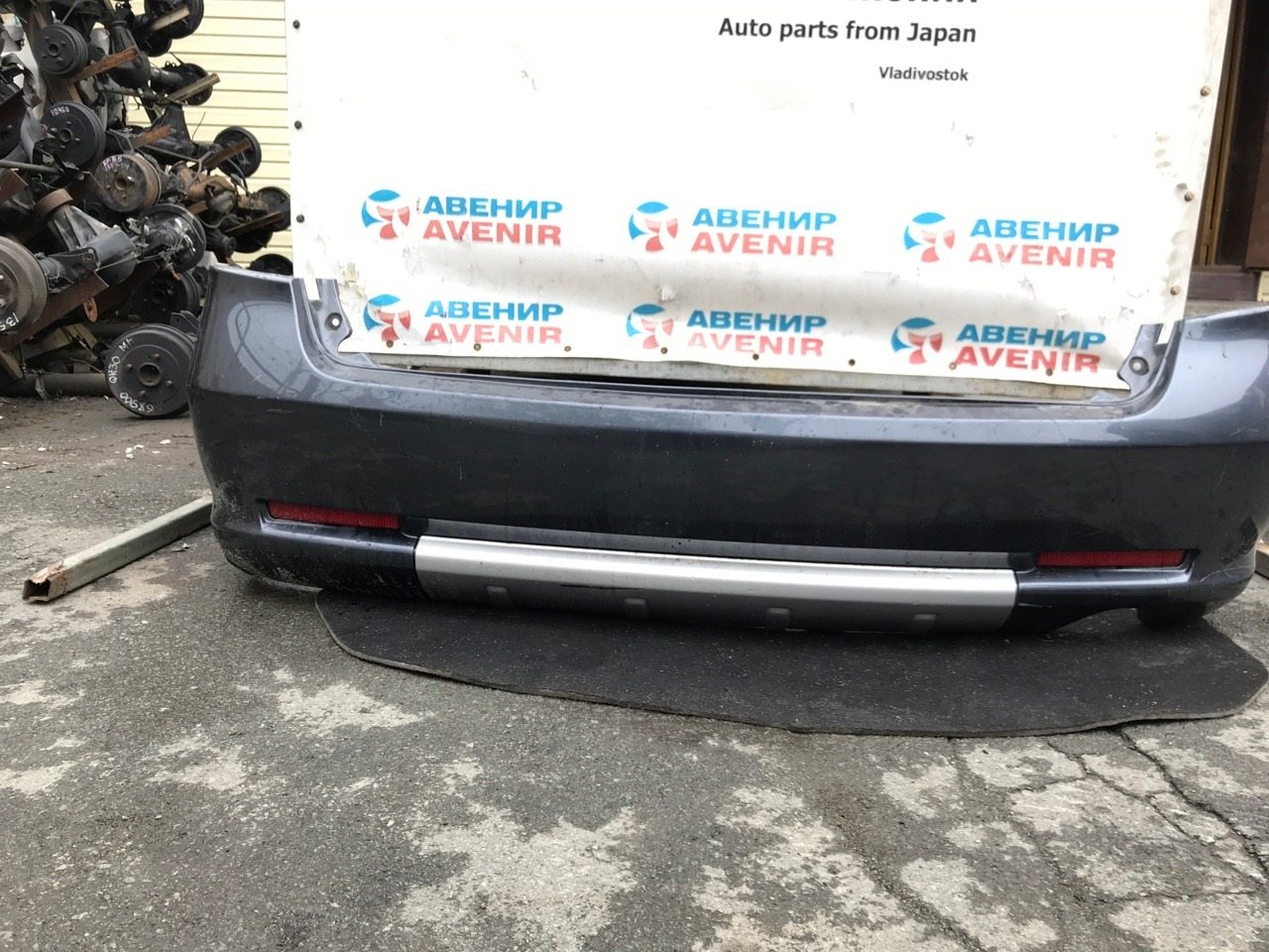 Бампер Mitsubishi Grandis NA4W задний