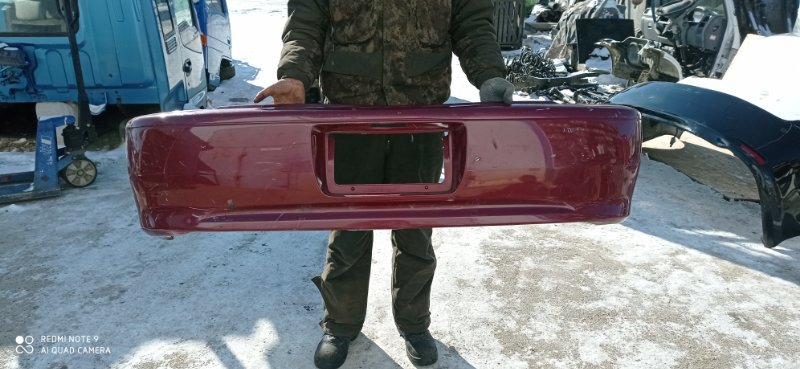 Бампер Toyota Corolla Spacio AE111 задний