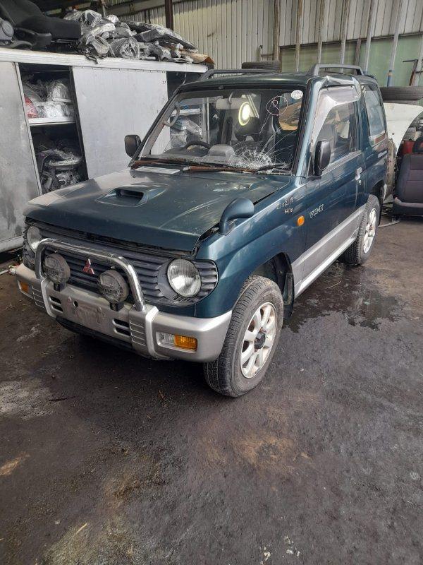 Клык бампера Mitsubishi Pajero Mini H56A 4A30 1995 передний левый