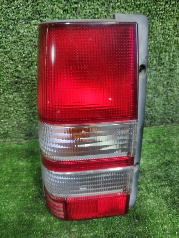 Стоп-сигнал Mitsubishi Pajero Junior H57A 4A31 1998 задний левый (б/у)