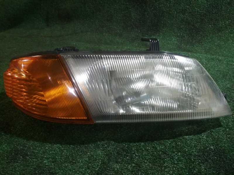 Фара Mazda Familia BVFY11 QG15 правая